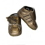 Gold and black adidas soft-sole shoes