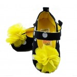 Black and white polka dot soft-sole shoes with yellow flower